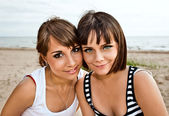 Young girlfriends on a beach — Stock Photo