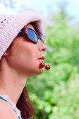 Woman with cherries — Stock Photo