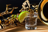 Saxophone and tequila with lime — Stock Photo