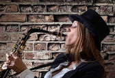 Young beautiful woman with saxophone — Stock Photo