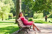 young pregnant woman in park — Stock Photo