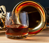 Saxophone and whiskey  — Стоковое фото