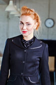 young beautiful woman in  black jacket — Стоковое фото