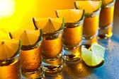 Tequila and lime on glass table — Stock Photo