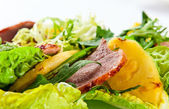 Salad with  pineapple and smoked meat — Stock Photo