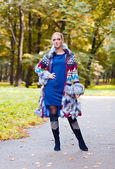 Girl in a knitted coat  — Stock Photo