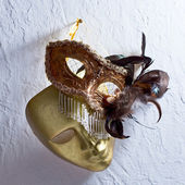 Venetian masks on  old wall — Stock Photo