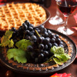 Fresh grapes and glass of wine — Stock Photo