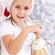 Girl hold Christmas bell — Stock Photo