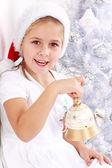 Girl hold Christmas bell — Stock Photo