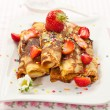 Stock Photo: Rolled crepes with fresh strawberries