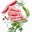 Salami with herbs and chili - Stock Photo