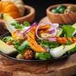 Field salad with grilled pumpkin — Stock Photo