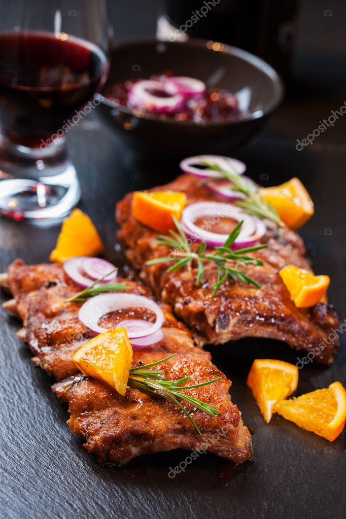BBQ spare ribs marinated in orange sauce with herbs and wine — Stock Photo #13394562