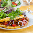Omelet filled with chanterelle mushrooms - Stock Photo
