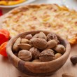 Nuts in bowl with apple pie — Stock Photo #13703838