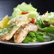 Fish on green asparagus with salad — Stock Photo