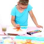 Schoolgirl painting — Stock Photo #13840792