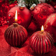 Christmas candles and balls in red - Stock Photo