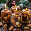 Rustic Christmas candles with spices and  nuts — Stock Photo