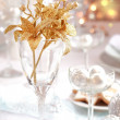 Golden branch on Christmas table - ストック写真