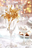 Golden branch on Christmas table — Stock Photo