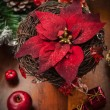 Christmas flower with decoration on wooden table — Stock Photo #15310763