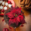 Christmas flower with decoration on wooden table — Stock Photo #16760607