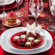 Place setting Christmas with paper star — Stock Photo #16956659