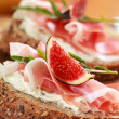 Sandwich with prosciutto and goat cheese - Stock Photo