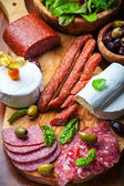 Antipasto catering platter with different meat and cheese products — Stock Photo