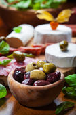 Fresh olives with antipasto catering platter — Stock Photo