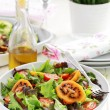 Delicious salad with tamarillos — Stock Photo
