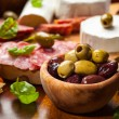 Fresh olives and antipasto catering platter — Stock Photo #22019081