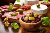 Fresh olives and antipasto catering platter — Foto Stock