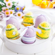 Easter eggs with spring flowers — Stock Photo #22062911
