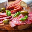 Salami catering platter with different meat and cheese products -  