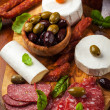 Appetizer catering platter with different meat and cheese products - Stock Photo