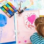Schoolgirl painting — Stock Photo #24697245