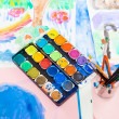 Water colors and brushes — Stock Photo