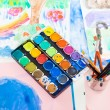 Water colors and brushes - Stock Photo