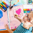 Schoolgirl painting — Stock Photo