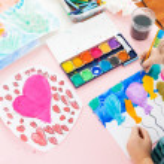 Schoolgirl painting — Stock Photo #24697699