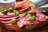 Salami catering platter with different meat and cheese products — Stock Photo