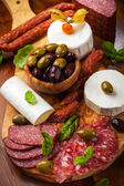 Appetizer catering platter with different meat and cheese products — Stock Photo