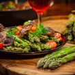 Roasted mushrooms with green asparagus - Stock Photo