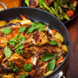 Roasted roasted rabbit on vegetables - Stock Photo