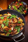 Roasted roasted rabbit on vegetables — Stock Photo
