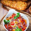 Baked feta cheese on vegetables — Stock Photo #25510091