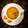Espresso cup in coffee beans — Stockfoto